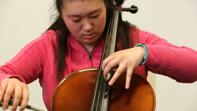 Yvonne Li plays her cello at Westview High School recently.