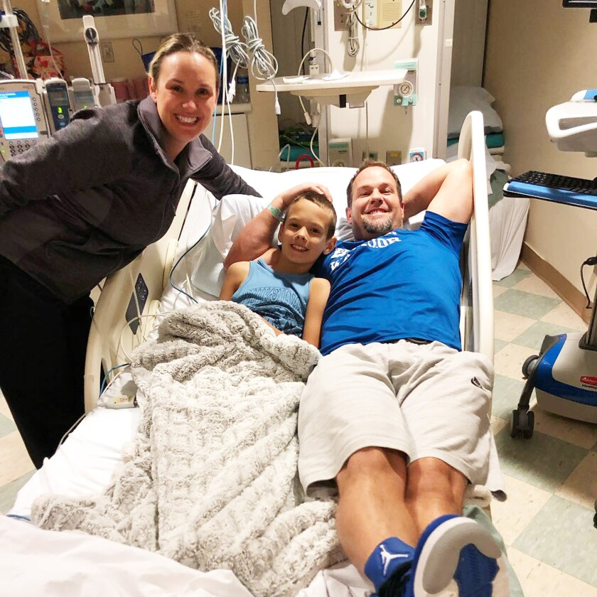 Cal Cella in the hosptial with parents Jessica and Dan Cella.