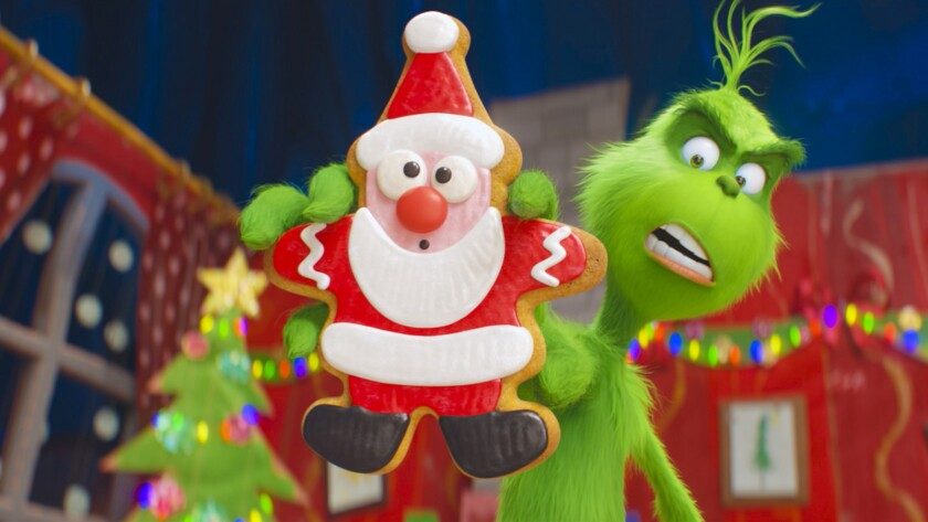 The Grinch (Benedict Cumberbatch) warns his dog Max and reindeer Fred about the seductive power of t