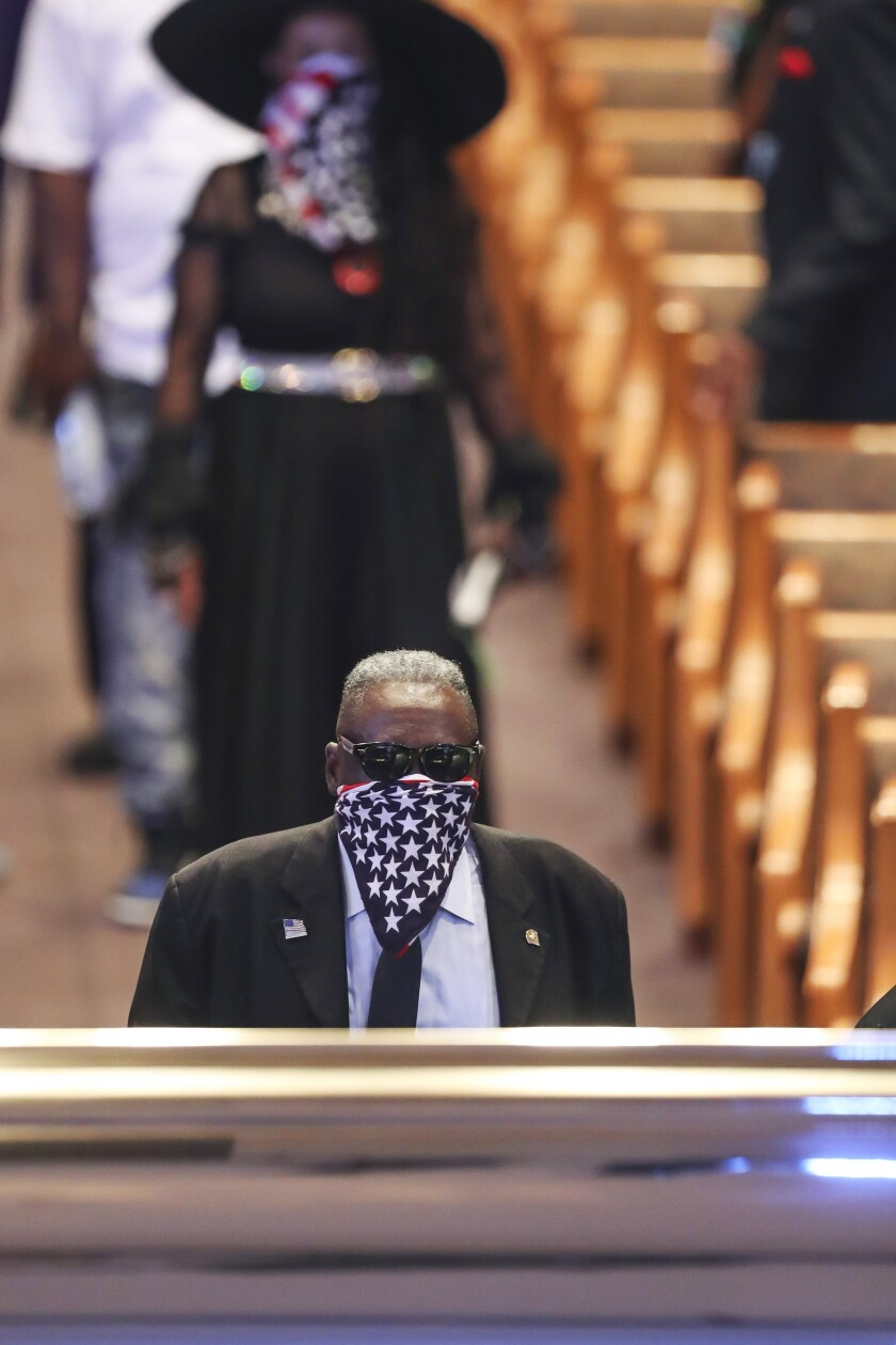 A mourner views the casket of George Floyd during a public visitation Monday, June 8, 2020, at The Fountain of Praise church in Houston. (Godofredo A. Vásquez/Houston Chronicle via AP, Pool)