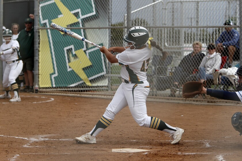 Edison's Izabella Martinez drives in a run against Marina in a Surf League game at Edison High on March 19, 2019.