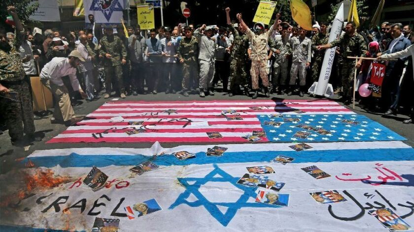 Iranian protesters burn representations of U.S. and Israeli flags and pictures of U.S. and British heads of state and Israel's prime minister in their annual pro-Palestinian rally.
