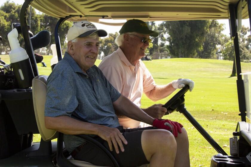 Dave Szumowski, left, plays a round of golf Wednesday with Dan Williams at Coronado Golf Course.