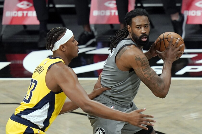 FILE - In this Feb. 10, 2021, file photo, Brooklyn Nets' DeAndre Jordan, right, looks for an outlet as Indiana Pacers' Myles Turner (33) defends during the first half of an NBA basketball game in New York. The Detroit Pistons acquired Jordan in a multiplayer trade with the Brooklyn Nets on Saturday, Sept. 4, 2021. The Pistons also received four second-round picks and cash considerations from the Nets in exchange for forward Sekou Doumbouya and center Jahlil Okafor.(AP Photo/Frank Franklin II, File)