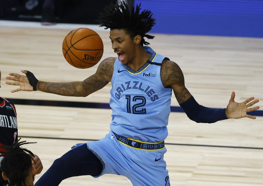 Memphis Grizzlies' Ja Morant reacts after a dunk against the Portland Trail Blazers during the second half of an NBA basketball game Saturday, Aug. 15, 2020, in Lake Buena Vista, Fla. (Kevin C. Cox/Pool Photo via AP)