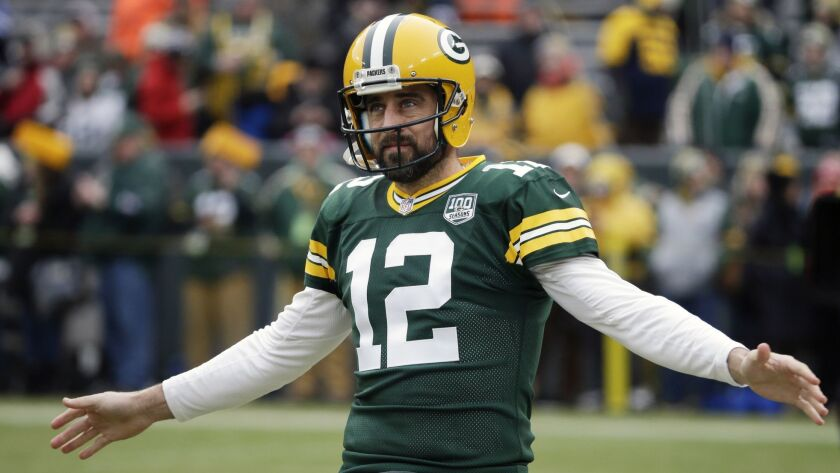 FILE - In this Dec. 30, 2018, file photo, Green Bay Packers' Aaron Rodgers warms up before an NFL fo