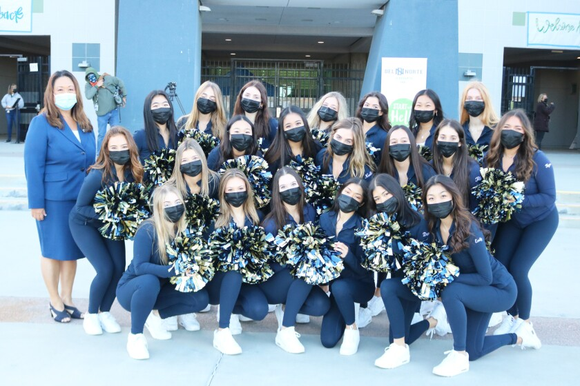 Supt. Marian Kim Phelps with the Del Norte High School dance team on Monday.