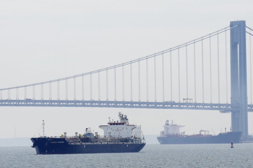A chemical and oil products ship enters New York Harbor, Wednesday, June 3, 2015.  The U.S. trade deficit declined sharply in April as exports posted a modest gain and imports fell, raising hopes that trade's drag on economic growth will ease in the current quarter. A boom in U.S. energy production