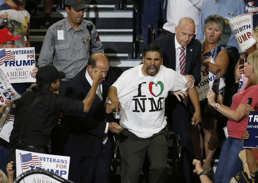 A protester is taunted as he is removed from a Donald Trump rally in Albuquerque on May 24, 2016.