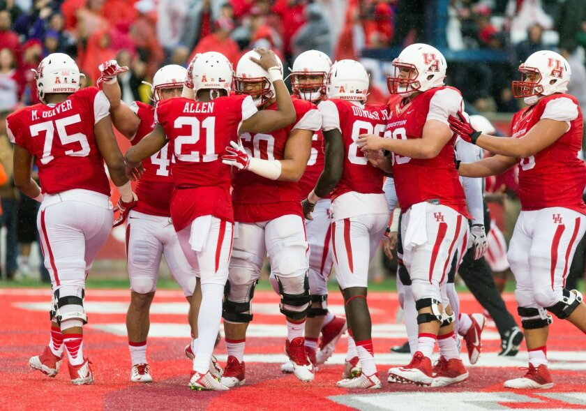 Houston's team celebrate in the end zone after scoring during the first half of an NCAA college football game against Cincinnati at TDECU Stadium, Saturday, Nov. 7, 2015, in Houston. (AP Photo/Juan DeLeon)