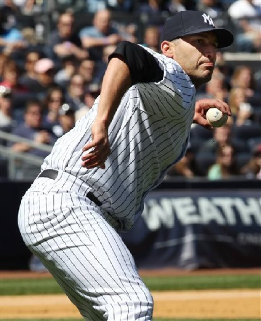 New York Yankees starting pitcher Andy Pettitte throws out Oakland Athletics Josh Donaldson after dropping his glove in the fifth inning of a baseball game in New York on Sunday, May 5, 2013. (AP Photo/Peter Morgan)