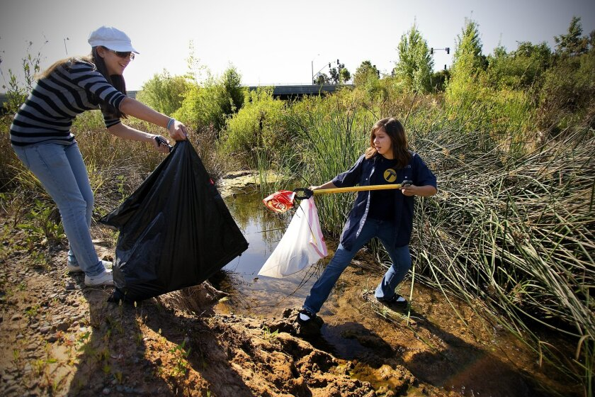 Tori Blaylock (left) and Anna Bowman from GirlScout Troop 6093 take part in the Ninth Annual Creek to Bay Clean Up at Forester Creek in Santee.