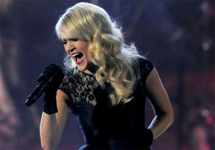 """Carrie Underwood has been chosen to perform the opening theme for """"Sunday Night Football,"""" replacing Faith Hill."""