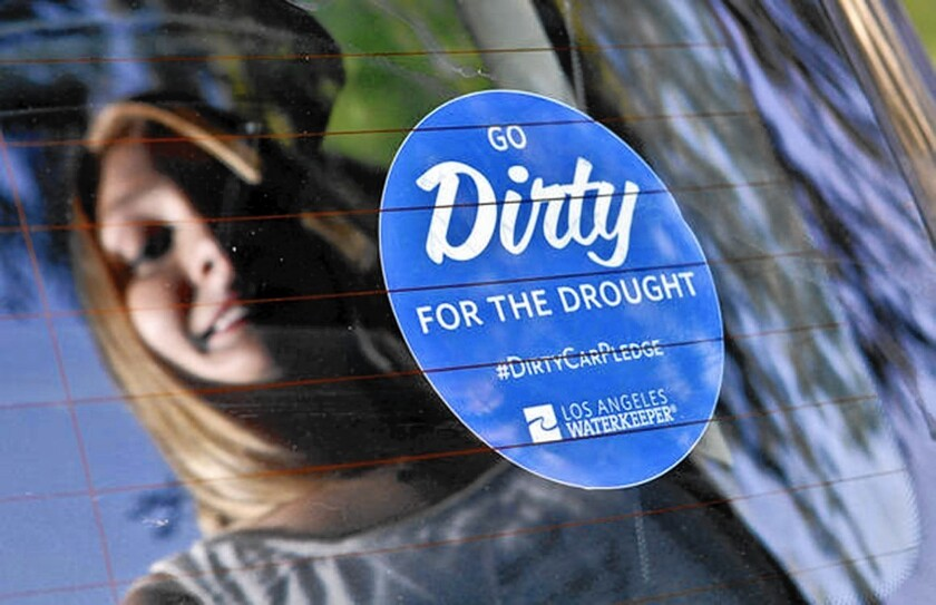 "More than 300 Burbank city vehicles will go unwashed for at least two months as part of a new conservation program. City officials have requested that 350 blue stickers reading ""Go Dirty for the Drought"" be placed in car windows to bring attention to the state's historic dry spell."