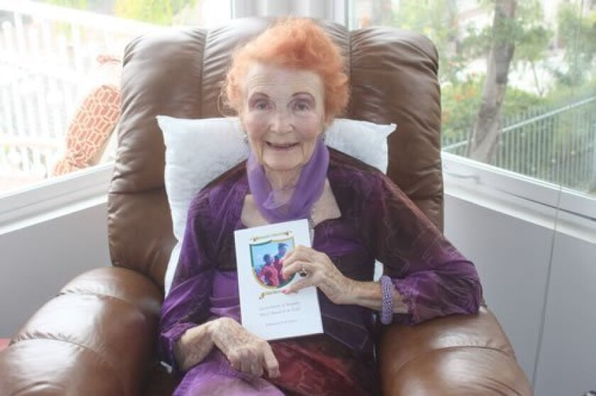 """Doris Sutton at her La Jolla home with her book, """"Romantic Tales from Old Mulvedania"""""""