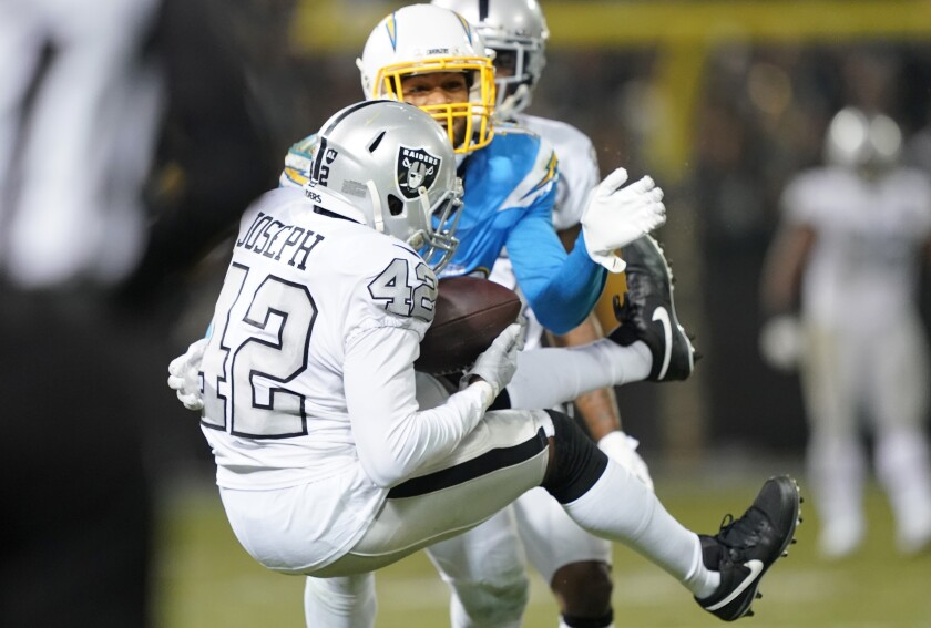 Raiders safety Karl Joseph intercepts a pass from Chargers quarterback Philip Rivers on Nov. 7.