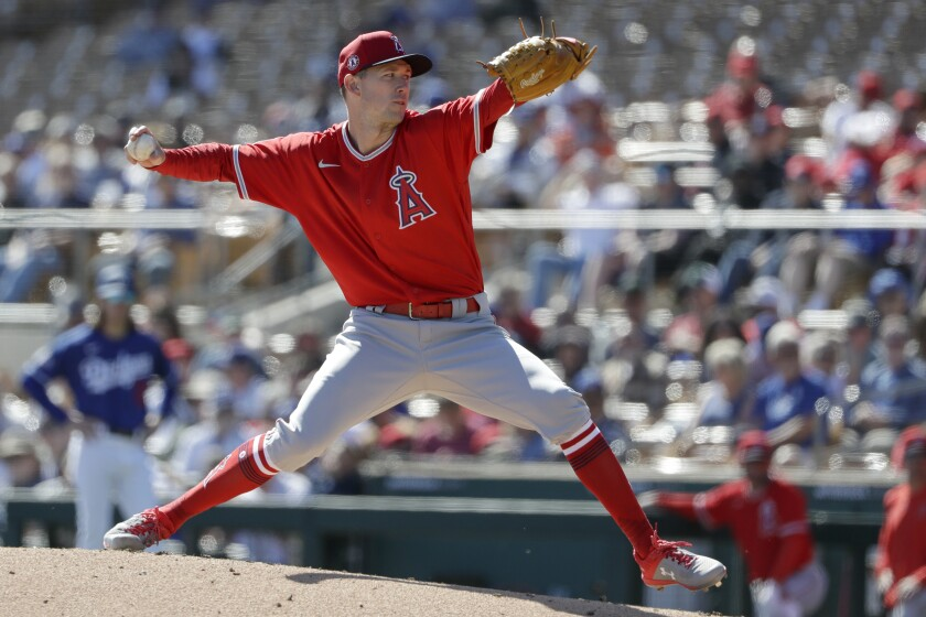 Angels starting pitcher Griffin Canning works against a Dodgers batter during the first inning of a spring training game on Wednesday in Phoenix.