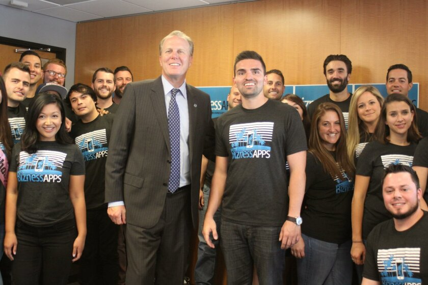 San Diego Mayor Kevin Faulconer with Bizness Apps CEO Andrew Gazdecki and the whole team