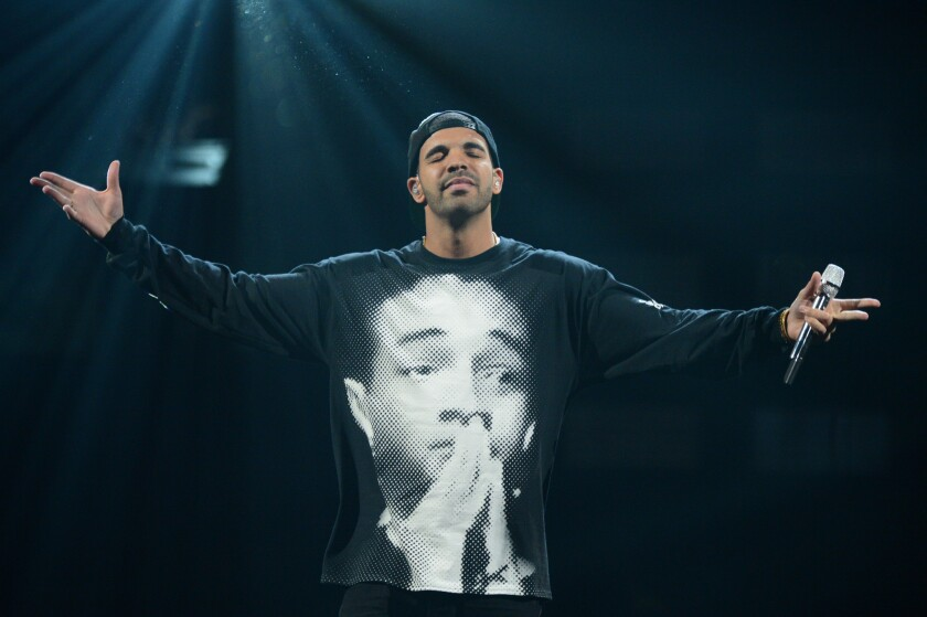 """Drake, seen performing at the iHeartRadio Music Festival, entered the Billboard 200 this week at No. 1 with his album """"Nothing Was the Same."""""""