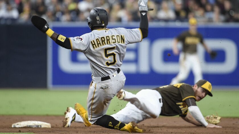 Pittsburgh's Josh Harrison slides safely into second base as Cory Spangenberg is pulled off the base by a flip from Freddy Galvis' glove. The error ended up allowing two unearned runs to score in the third inning.