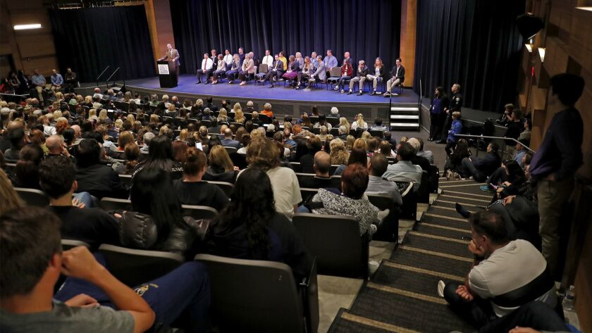 Hundreds gather to listen to speakers during a second community meeting at Corona del Mar High Schoo