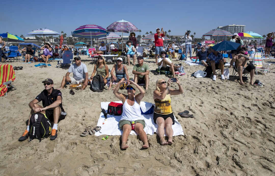 Spectators watch as aircraft perform during the Pacific Airshow
