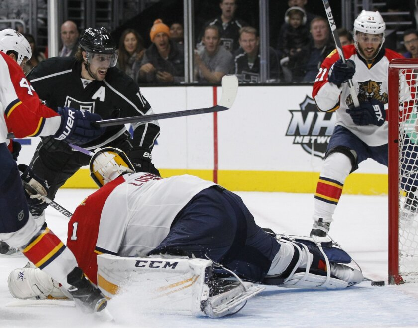 Los Angeles Kings center Anze Kopitar, top left, of Slovenia, reacts as he scores against Florida Panthers goalie Roberto Luongo (1) during the second period of an NHL hockey game in Los Angeles, Saturday, Nov. 7, 2015. (AP Photo/Alex Gallardo)
