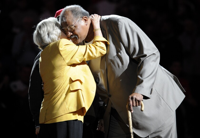 Wes Unseld is greeted by Irene Pollin, wife of the late Washington Bullets owner Abe Pollin, during a 2013 ceremony.