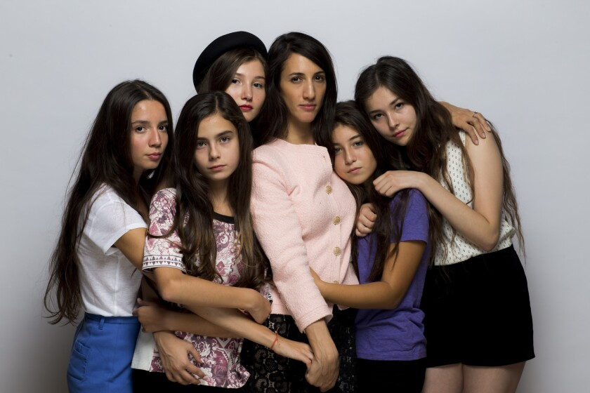 """Director and writer Deniz Gamze Ergüven, center, and the cast of """"Mustang"""": from left, Elit Iscan, Günes Sensoy, IIayda Akdogan, Doga Zeynep Doguslu, and Tugba Sunguroglu, are seen in the Los Angeles Times photo studio at the 40th Toronto International Film Festival on Sept. 11, 2015."""