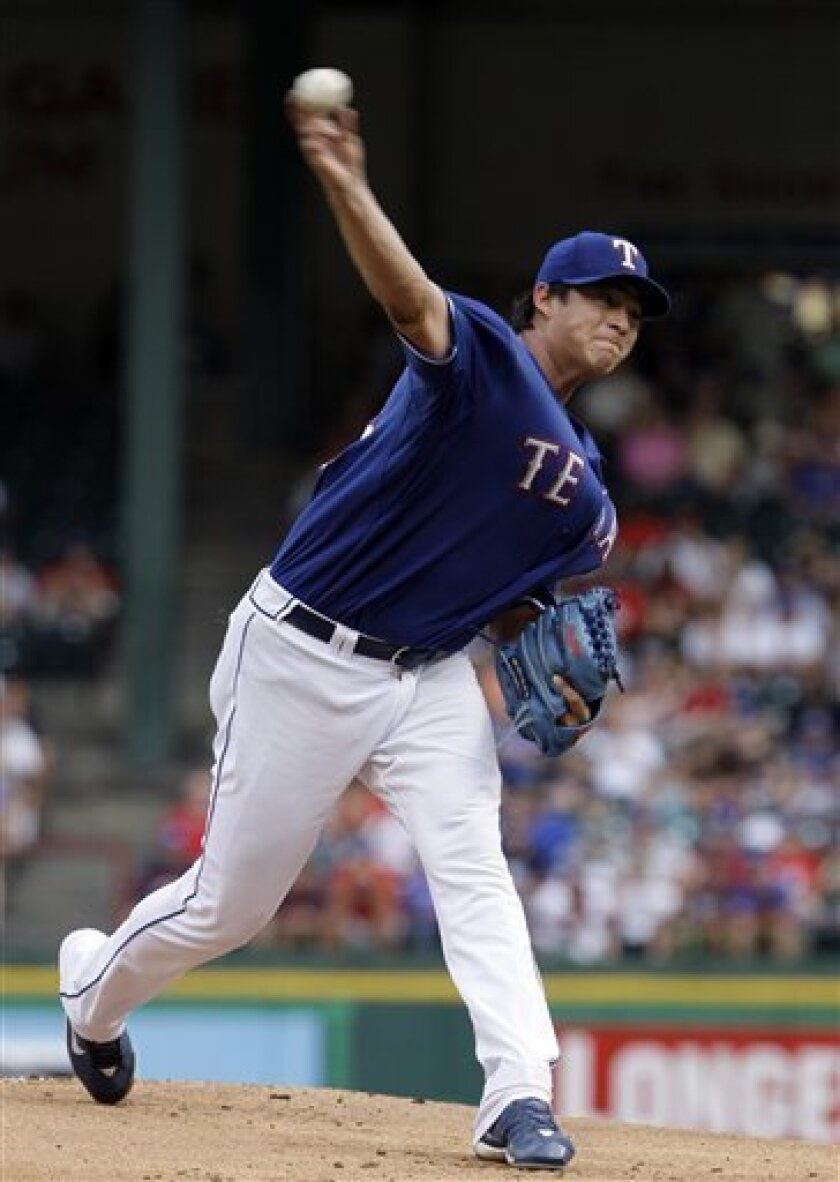 Texas Rangers starting pitcher Luis Mendoza throws in the first inning of the baseball game against the Chicago White Sox in Arlington, Texas, Friday, July 11, 2008. (AP Photo/LM Otero)
