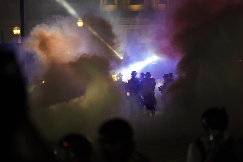 Police and protesters clash in Kenosha, Wis., on Aug. 25.