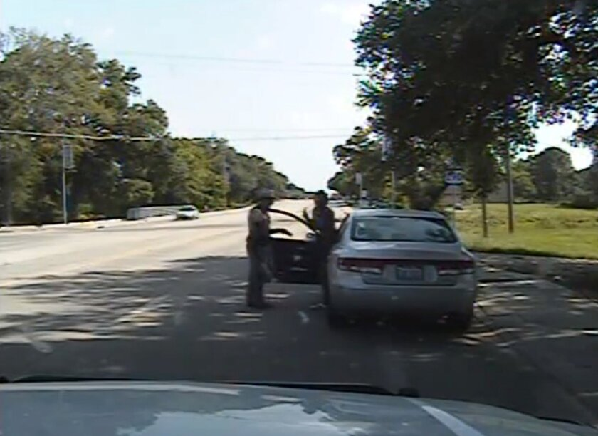 In this frame from a police dashboard video provided by the Texas Department of Public Safety, Trooper Brian Encinia encounters Sandra Bland before arresting her July 10 in Waller County, Texas.