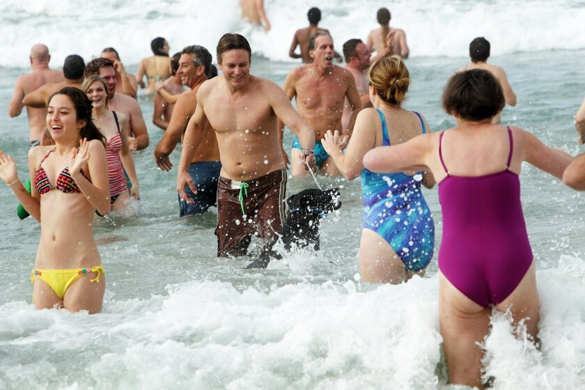 Locals plunge into the 55-degree water at Del Mar Beach. Photos/Jon Clark
