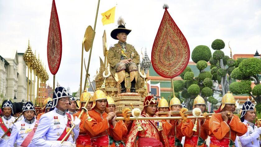 King Maha Vajiralongkorn is transported on the royal palanquin during his 2019 coronation