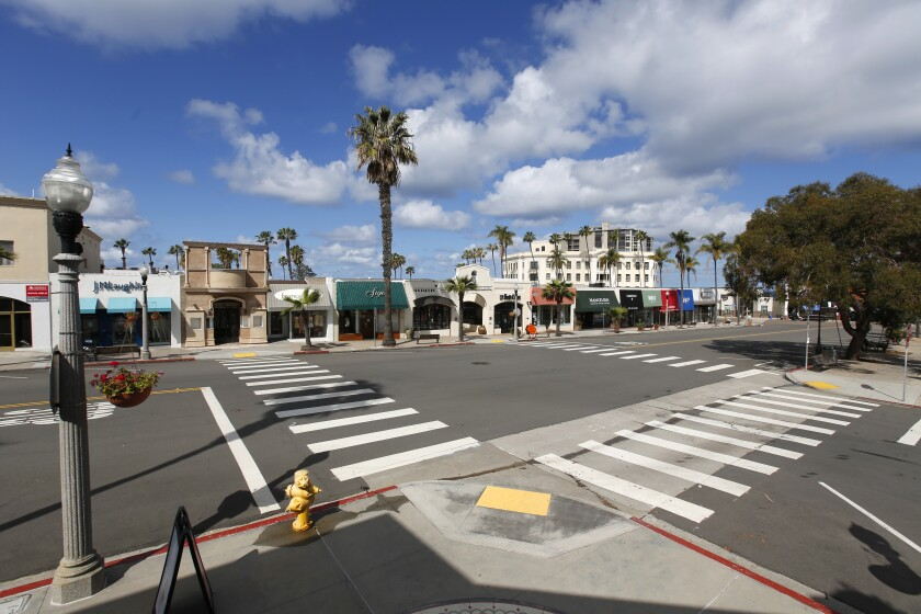 The normally busy Girard Avenue in the Village of La Jolla is cleared out because of Gov. Gavin Newsom's stay-at-home order and state-mandated closure of non-essential businesses during the coronavirus pandemic; as shown here March 26, 2020.