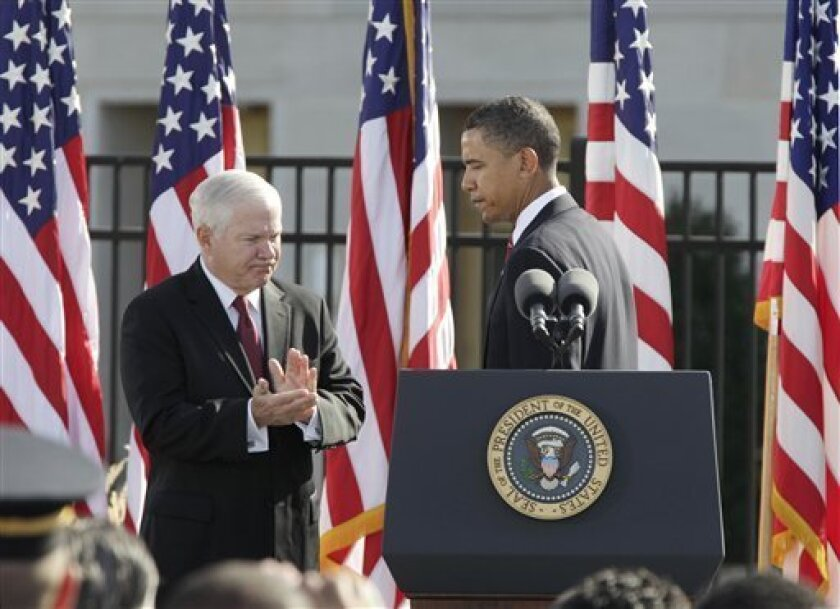 Defense Secretary Robert Gates applauds after President Barack Obama speech during a ceremony of remembrance at the Pentagon to honor the victims of the September 11, 2001 terror attacks, Saturday, Sept. 11, 2010. (AP Photo/J. Scott Applewhite)