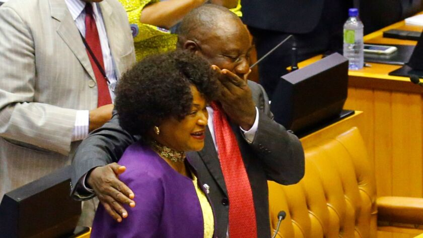 Cyril Ramaphosa hugs South African National Assembly Speaker Baleka Mbete before his swearing-in as South Africa's president on Feb. 15.