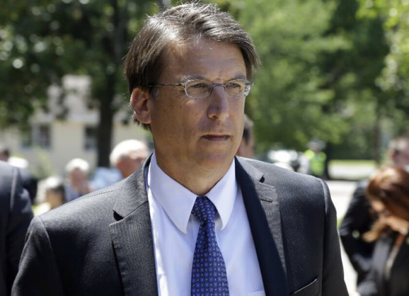 North Carolina Gov. Pat McCrory signed a strict new voter ID bill into law on Monday.