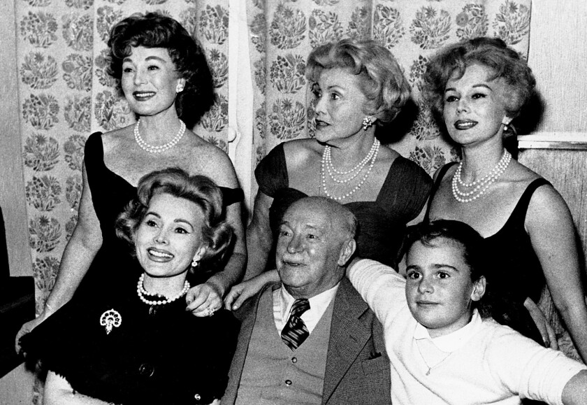 The Gabor family in 1958. From left, Zsa Zsa, Papa Vilmos Gabor, Francesca Hilton, Zsa Zsa's daughter. Standing behind are: Magda, Mama Jolie and Eva.