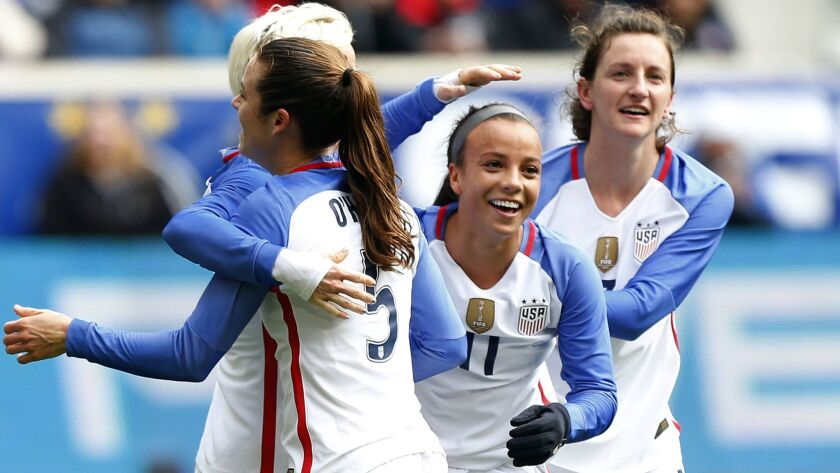 American forward Mallory Pugh (11) celebrates with teammates after scoring against France during a SheBelieves Cup women's soccer match on March 4, 2018, in Harrison, N.J.