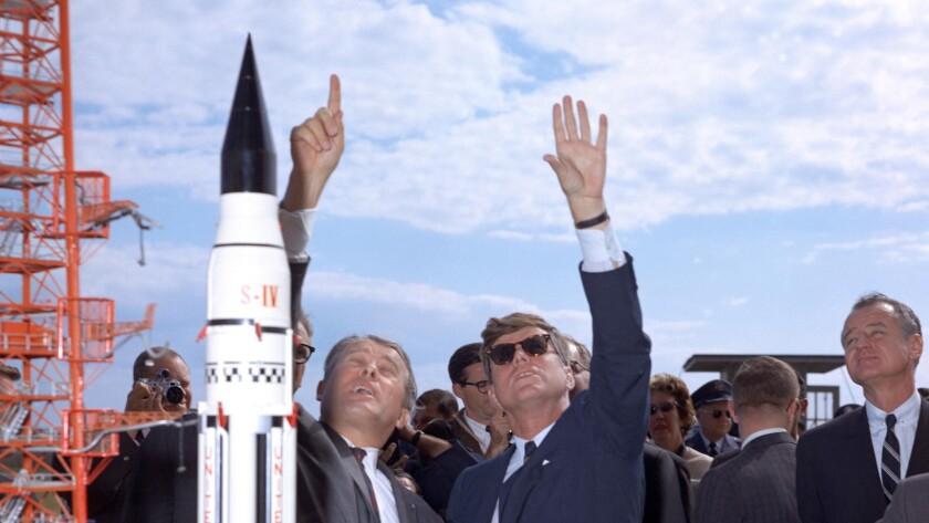 (L-R) - Dr. Werner Von Braun explains the Saturn system to President John F. Kennedy at Complex 37 w