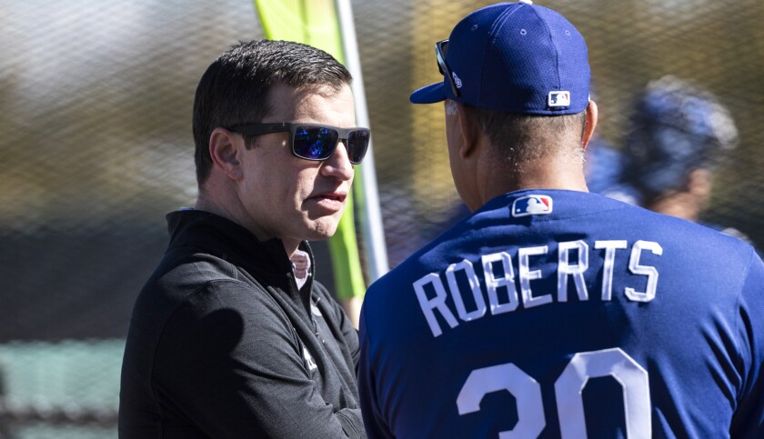 GLENDALE, AZ - FEBRUARY 19, 2019: Dodgers Manager Dave Roberts, right, talks with the President of