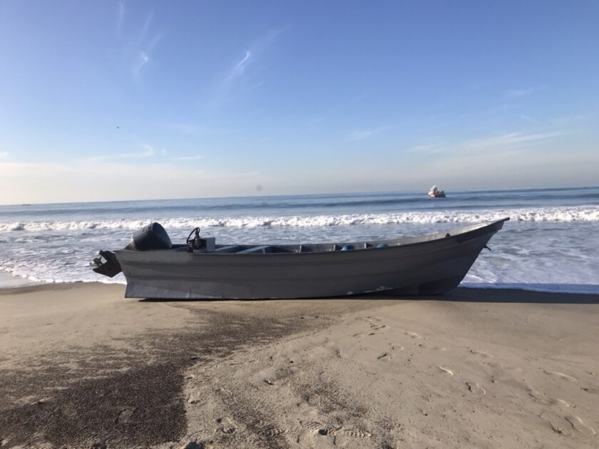 Border Patrol officials said 14 people fled from this panga boat after it landed early Monday morning at T Street Beach in San Clemente.