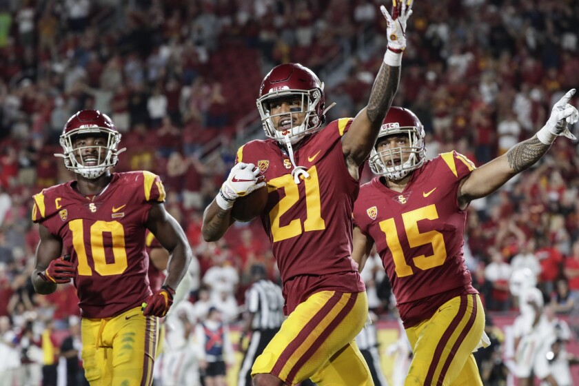 USC defensive back Isaia Pola-Mao celebrates with teammates.