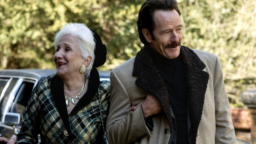 "Olympia Dukakis and Bryan Cranston in the movie ""The Infiltrator."""