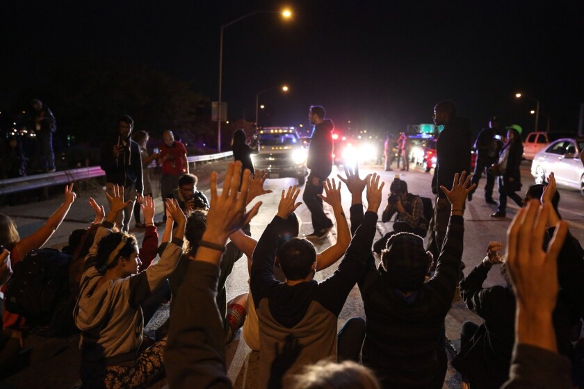 Protesters halt traffic in both directions on L.A.'s 110 Freeway near Leimert Park on Nov. 24.