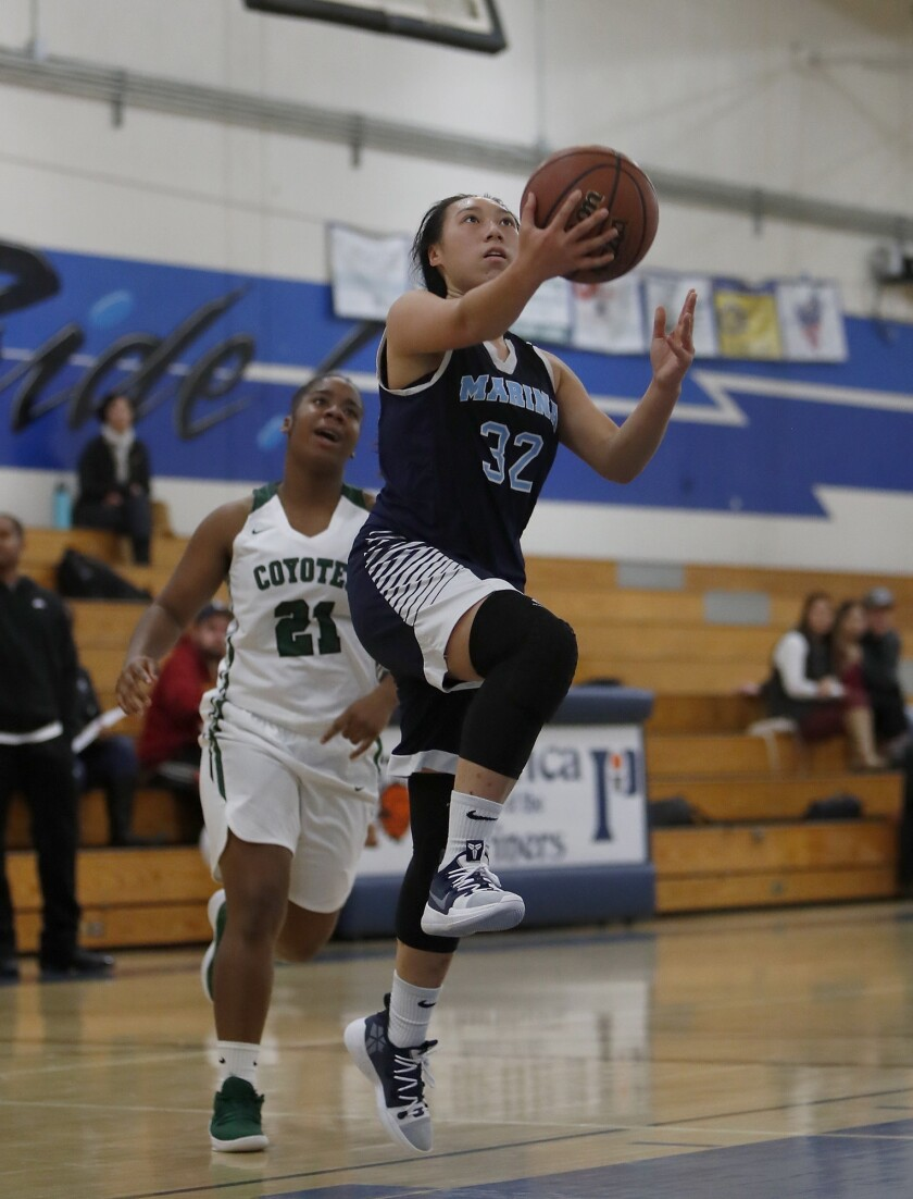 Marina High's Katie Nguyen (32) attempts to lay the ball in against Buena Park during the first half