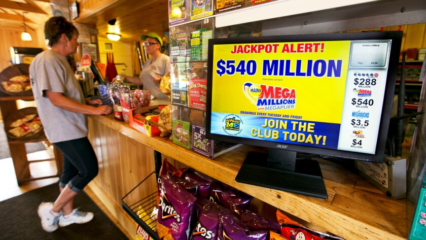 Stacie Miller, of Waldoboro, Maine purchases a Mega Millions lottery ticket at a store in Damariscotta, Maine on Friday.