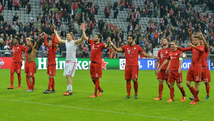 Munich's players celebrate after their Champions League Group F soccer match between Bayern Munich and Arsenal FC in Munich, southern Germany, Wednesday, Nov. 4, 2015. Munich won 5-1. (AP Photo/Kerstin Joensson)
