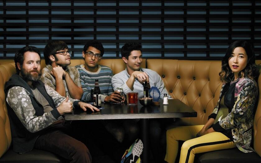 "Jon Daly, left, Charlie Saxton, Karan Soni, Joel Dinicol and Maya Erskine in Amazon's original series ""Betas."""